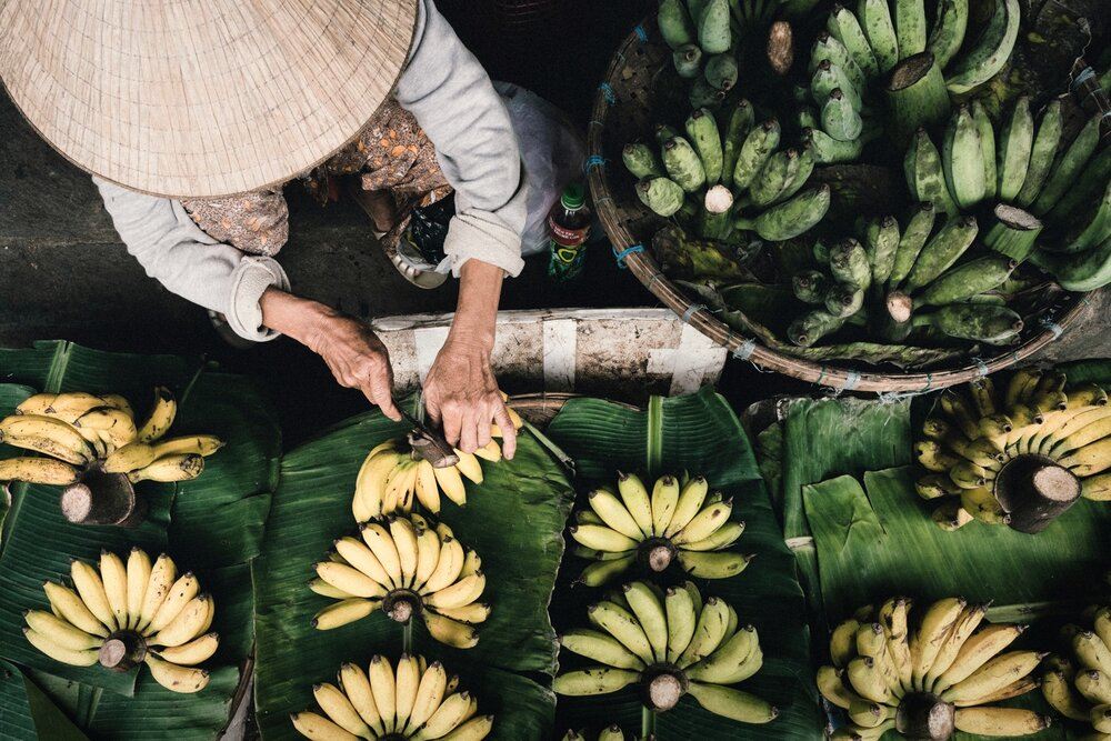 A woman sells bananas in Hoi An Market.