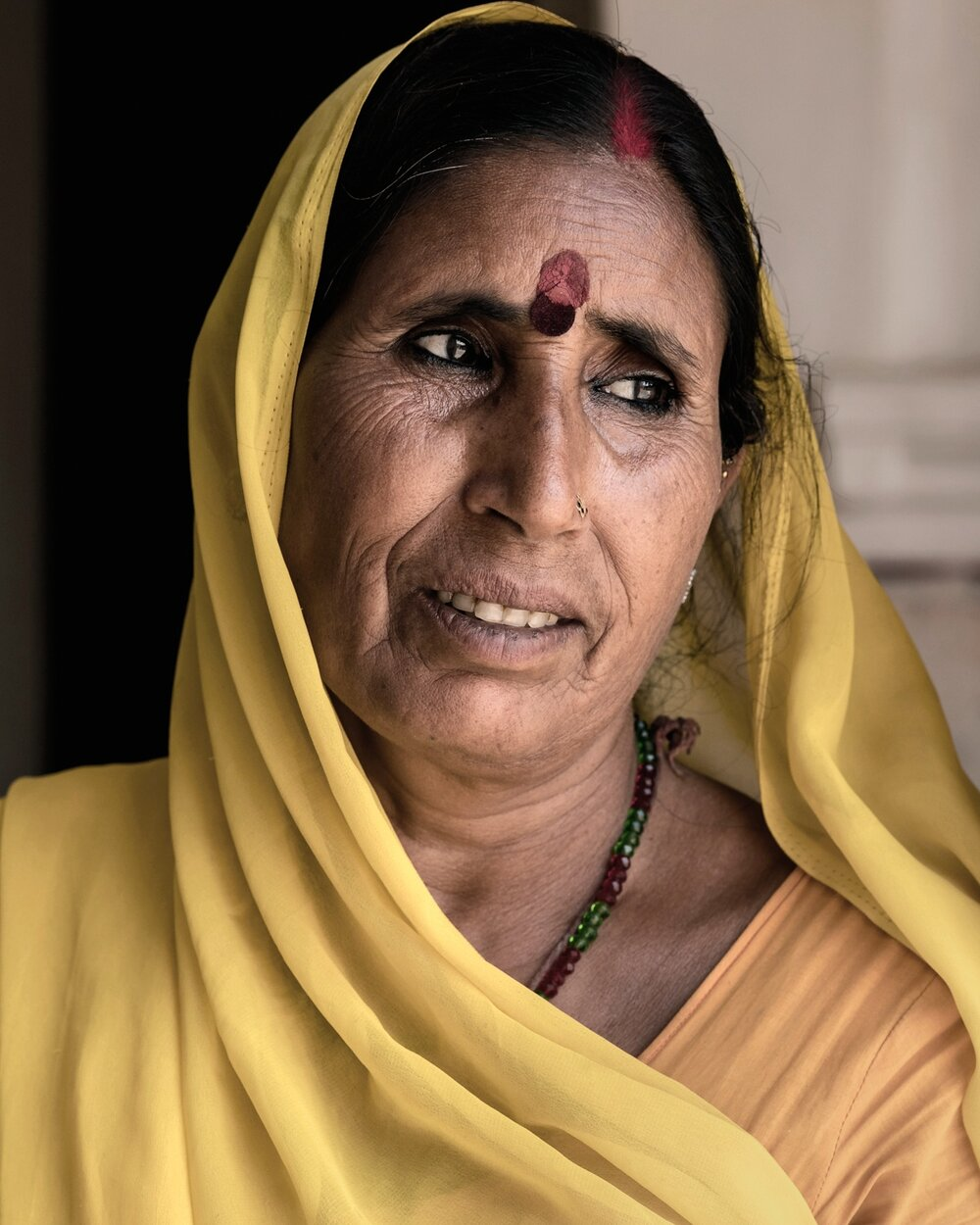 A woman wearing a traditional Saree in Amer Fort.