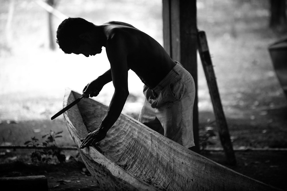 Kaufman_Alex_9_Man Carving Traditional Wood Boat.jpg
