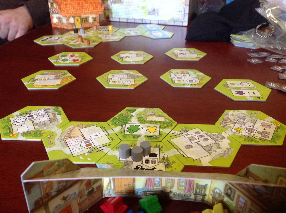 Yet another mechanic in the game is tile laying, very much like in Carcassone. And then there's resource management. And also you have to build a road. And... and...