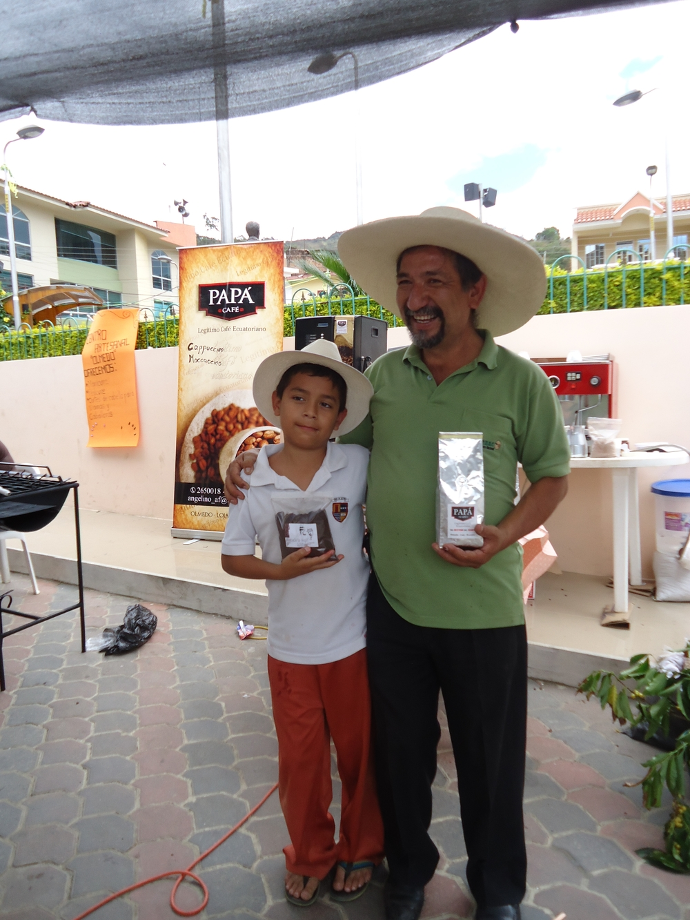 Angelino Abad with his son promoting his roasted coffee.