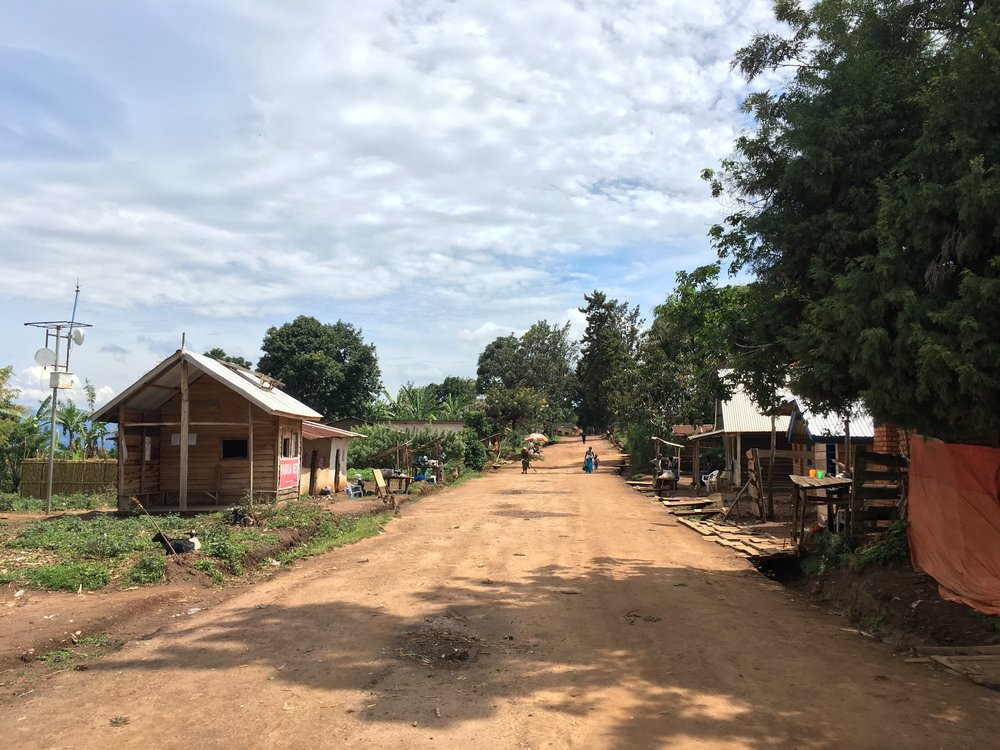 "Main street in Bugarula. The building on the left houses the first internet point on the island, part of a beautiful project by ""Project First Light""."