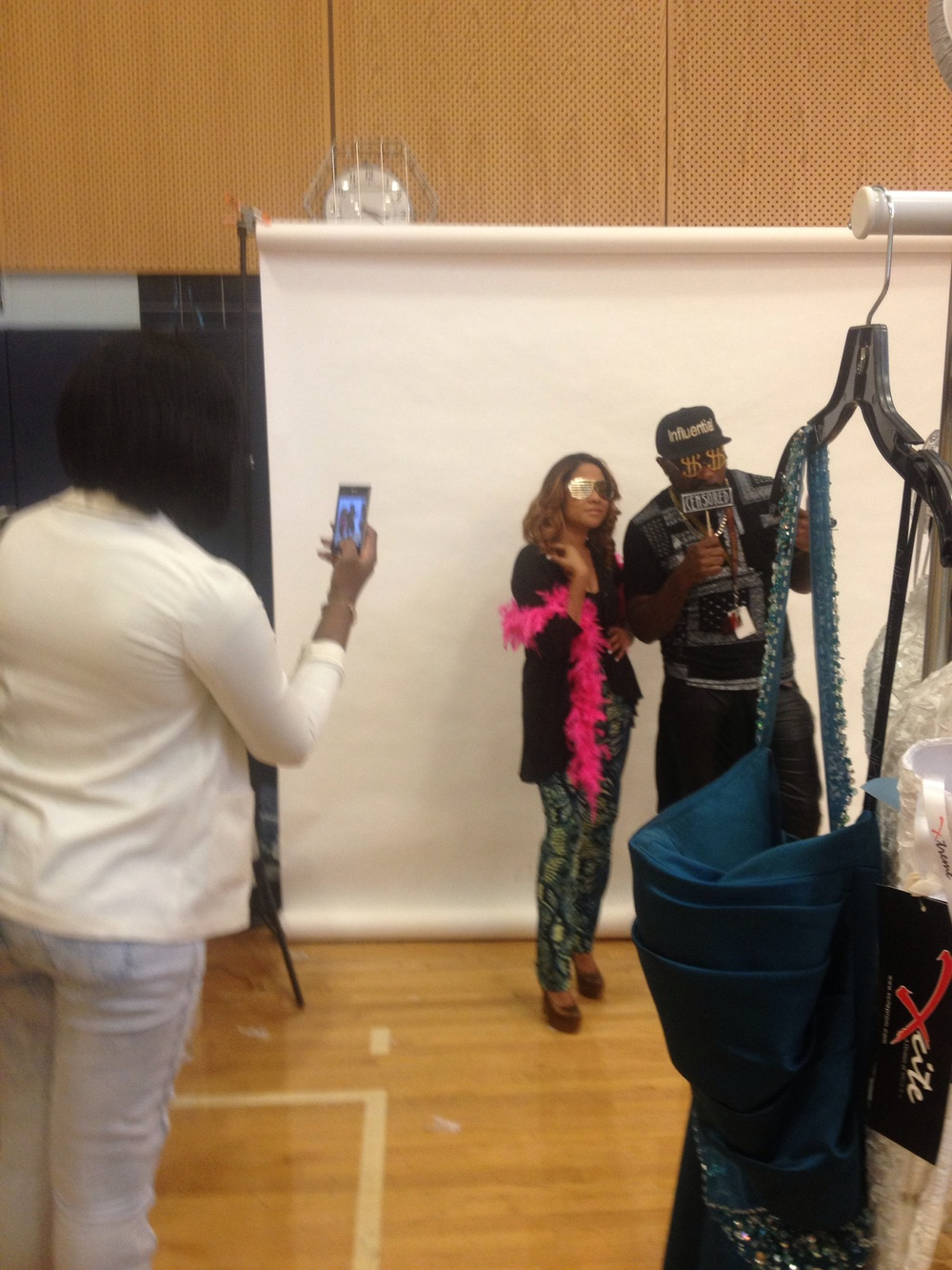 (Angela Yee having fun at the photo booth)