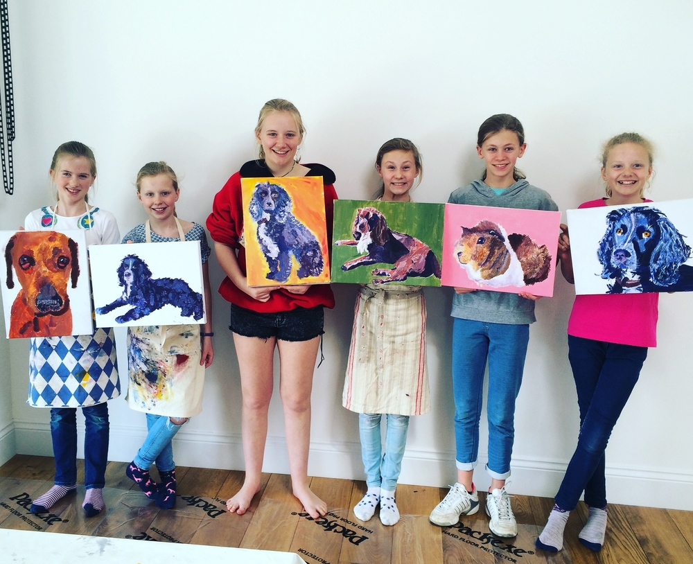 Quince Art School students with paintings of their pets