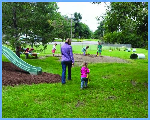 Teacher and children on playground