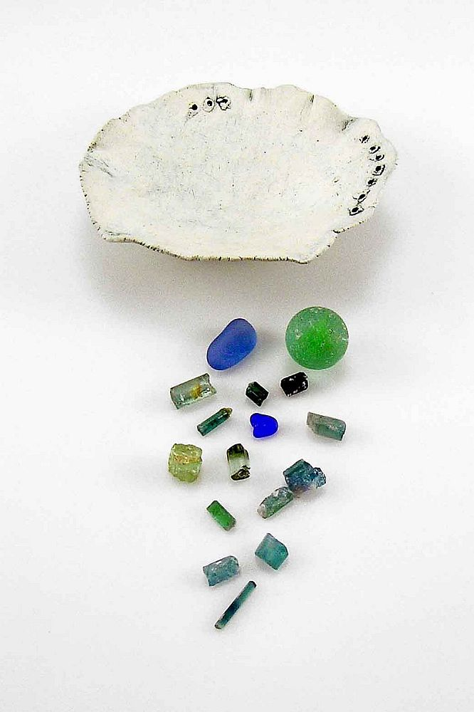 bluegreen pinchpot contents:  cobalt beach glass from PT, marble from our yard, tourmaline crystals