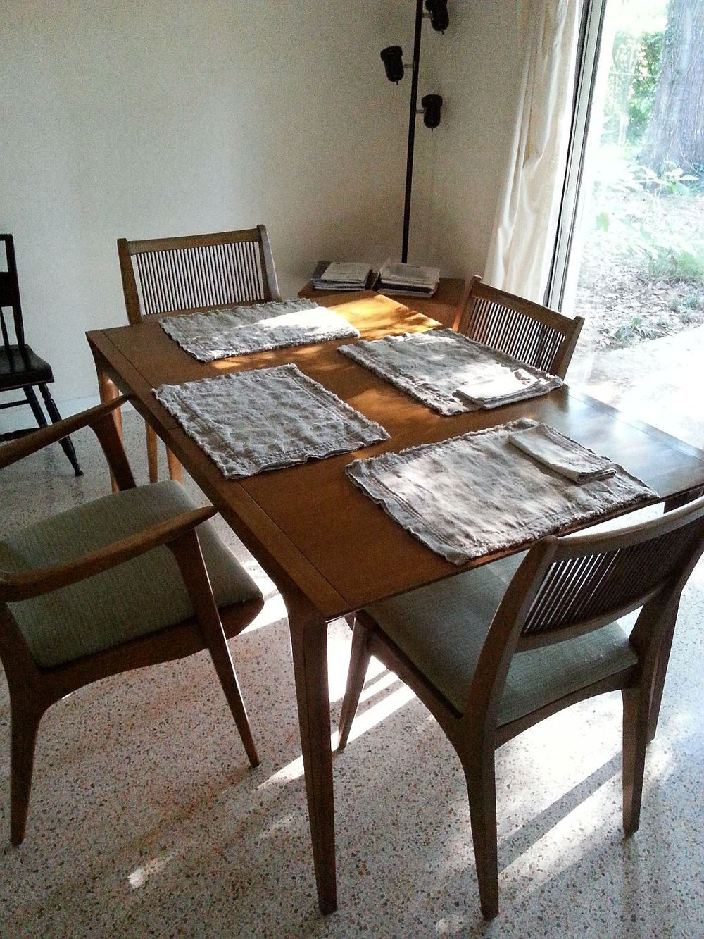 And I'm probably most excited about our major furniture score . . . a 1957 Drexel Profile dining table and 4 chairs . . . a mondo deal from an Ocala antique mall. I've seen these online with 6 chairs for close to $9k - here's the link! Including the cost of renting a van to go down and pick it up, our set was just under $600. I made the placemats with some of my stash of vintage homespun linen . . . they're perfect. Planning on an indigo linen to re-do the seats.