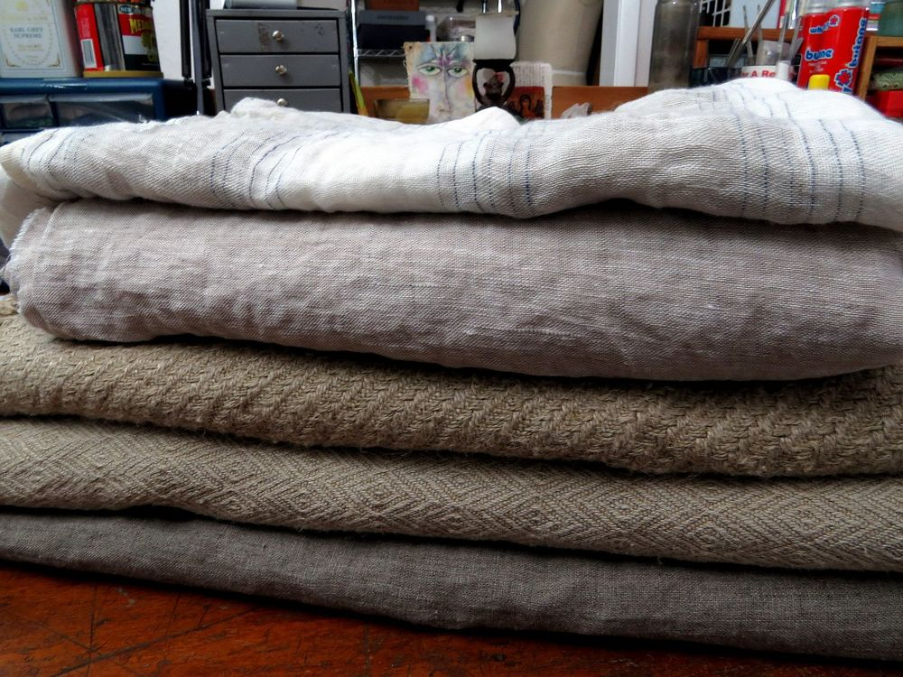 "Top is a sheer stripe from Lithuania, next is the 87"" wide 5oz from Latvia, next the really heavy hemp and then the not as heavy lovely jacquard weave hemp and then a  7 oz darker linen from Lithuania . . . yummy!  Still have to order the dark blue linen."