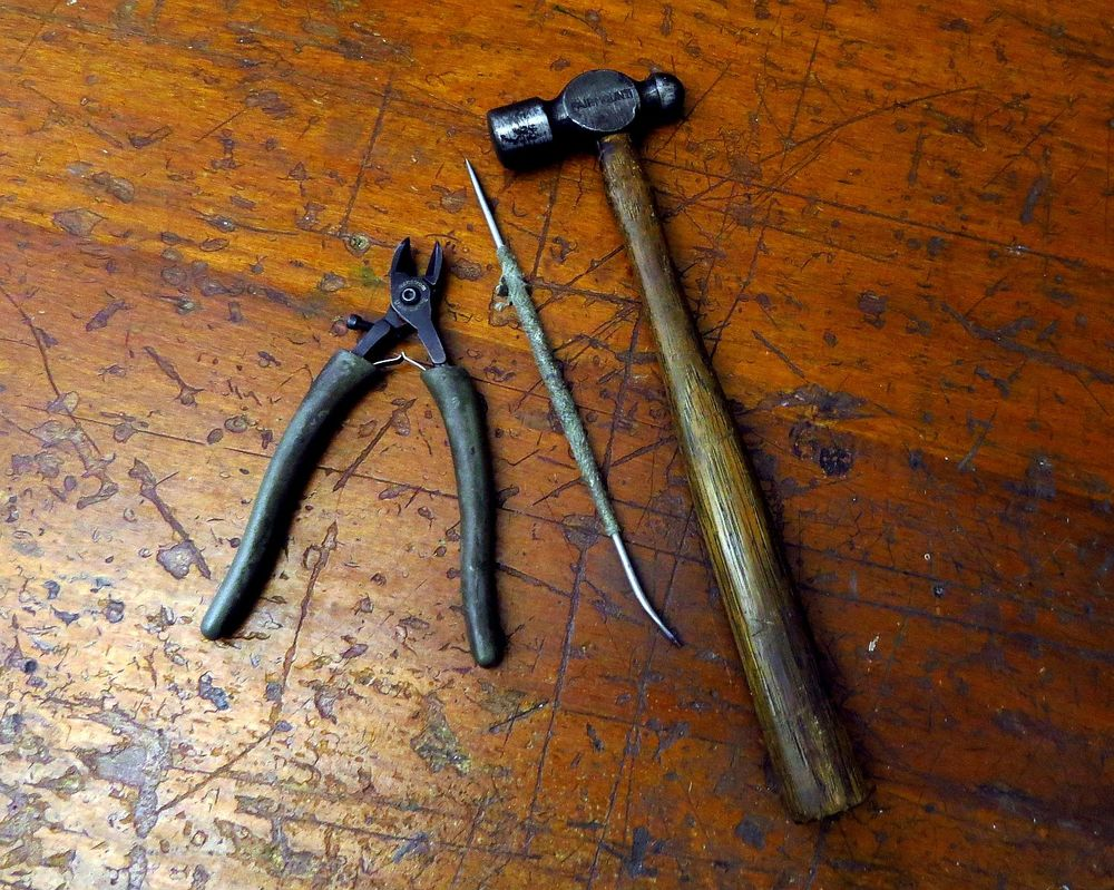 "well worn Swanstrom flush cutters, handmade steel ""pokie"" tool from the very first PMC tool kit circa 1997, ball peen hammer that belonged to legendary Asheville architect Anthony Lord"