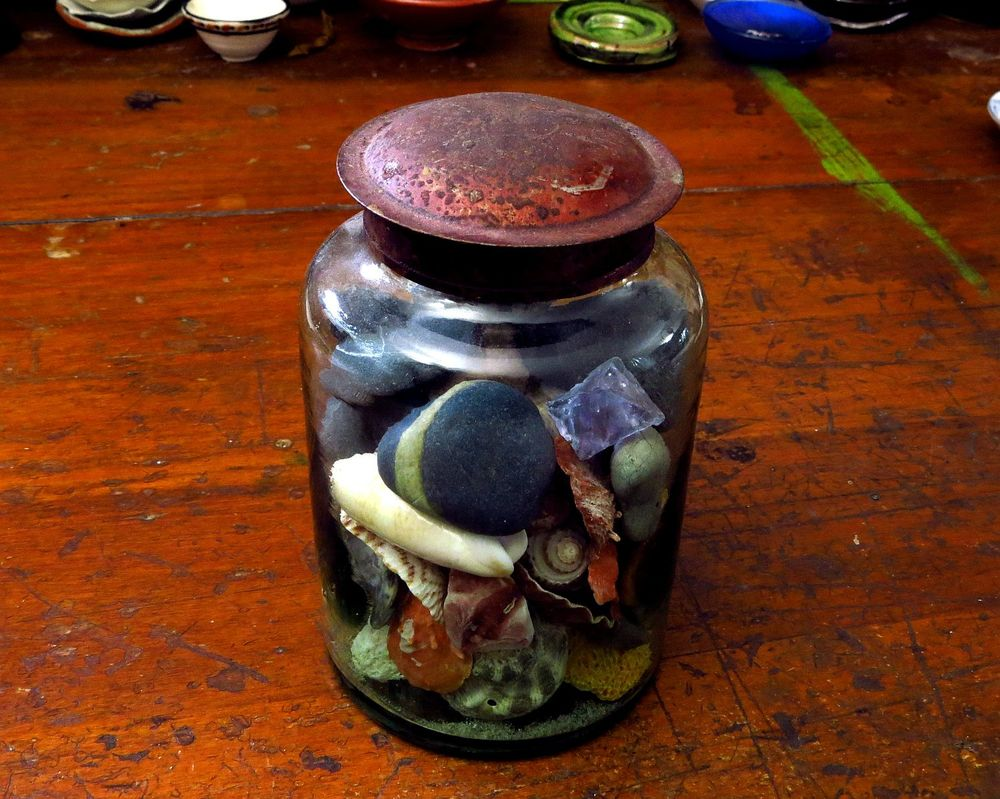 this glorious vintage jar with its divine patinated lid is full of collected rocks and shells - lovely bits from places we've lived and visited