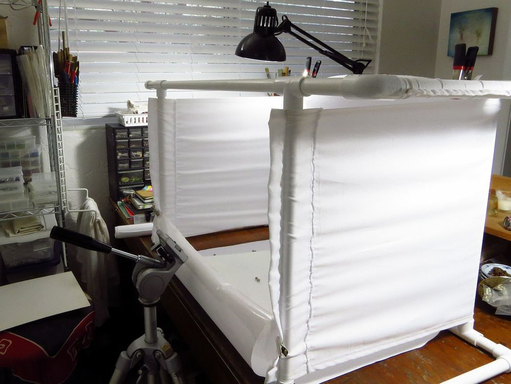 photo booth: pvc and cheap polyester fabric, about 15 bucks.  I can clip on backdrops, use all sorts of platforms for images, clip on lights in assorted places and the whole thing folds down flat