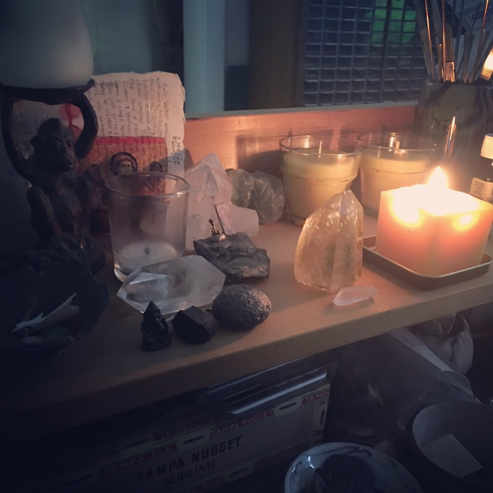 my desktop shrine lit with new beeswax candles