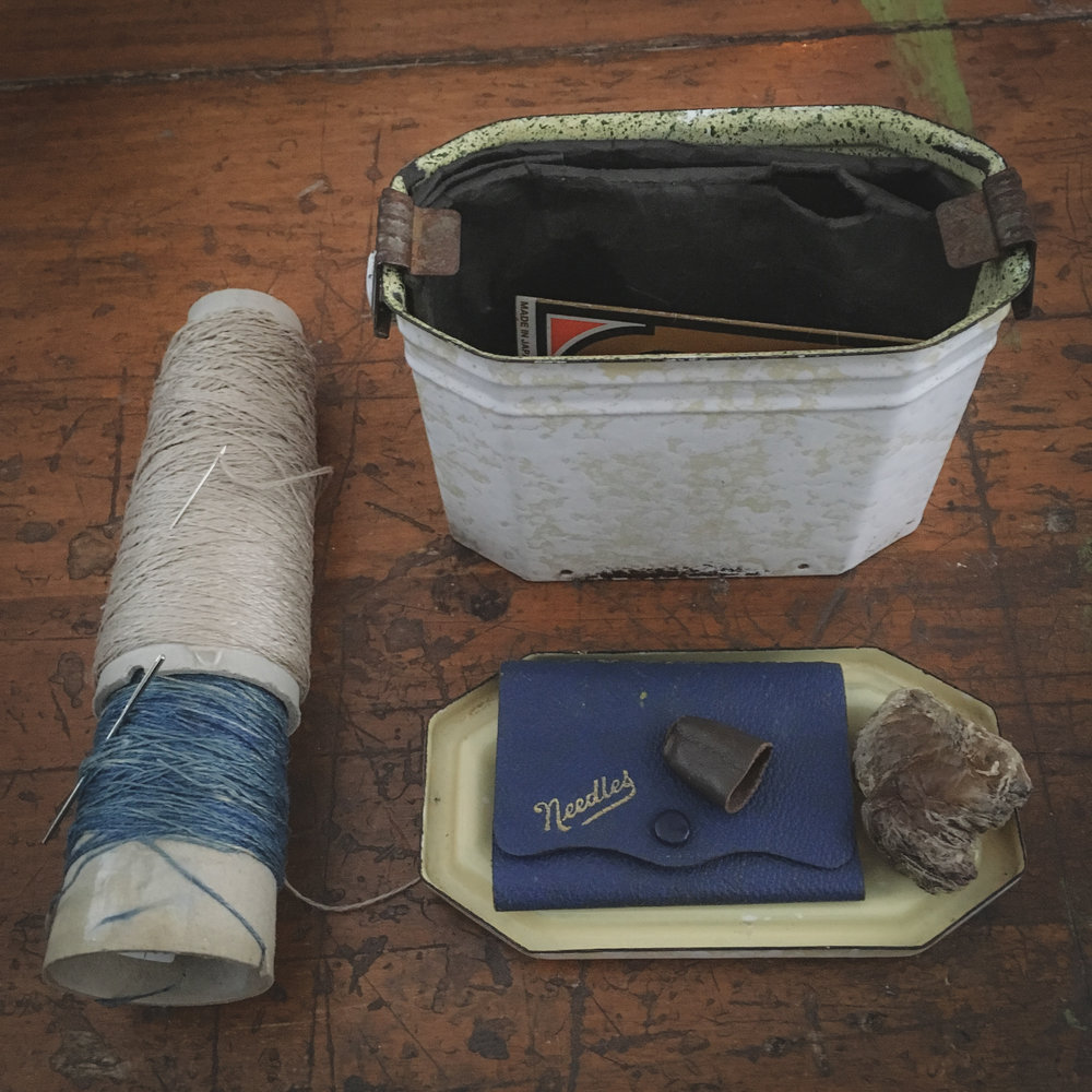 Euroflax linen, natural and indigo dyed … vintage French lunchbox as my needle storage … Dave's grandmother's needle case, my beloved old leather thimble and beeswax from my Grandfather's shoe repair shop, at least 100 years old …