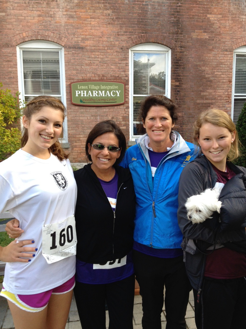 Caroline with her mom and big sis and close friend before the race.