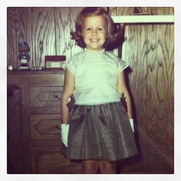Cathy has always been a lover of poofy skirts & parties. Pictured here at age six.