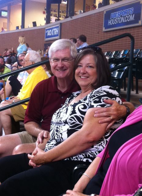 Brigitte with her husband, Dwight, at a Houston Astros game.