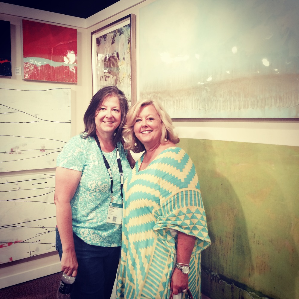 Brigitte and Cathy looking at some larger artwork.