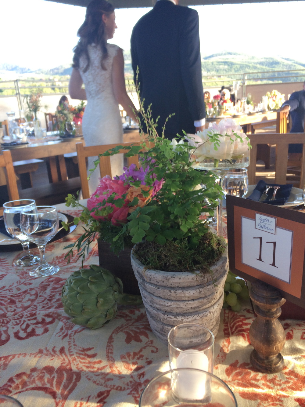 Tablescape (with bride & groom in the background.)