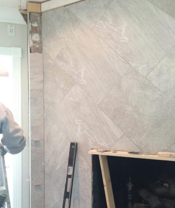 Here you can see the decaying brick that was under the black marble, and how our team used spacers before adding grout.
