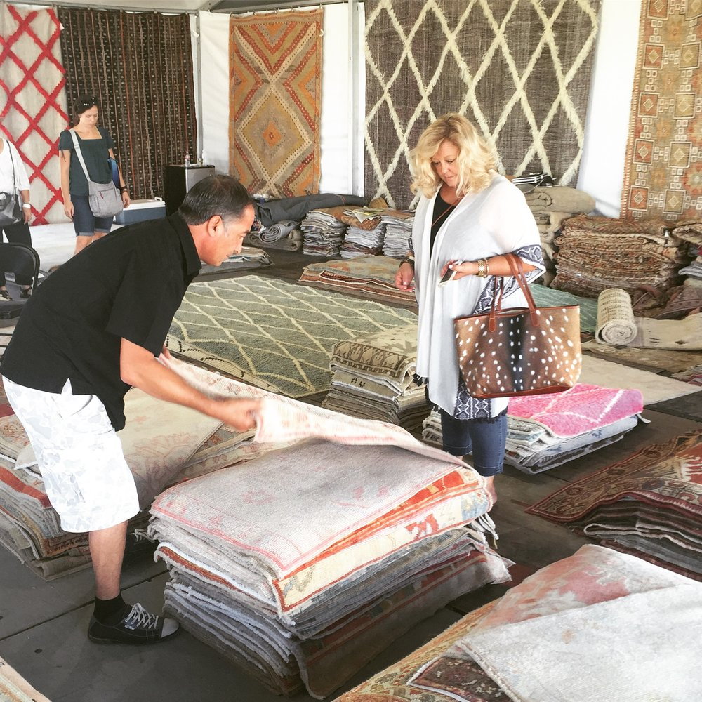 Cathy purchasing rugs at the Arbors
