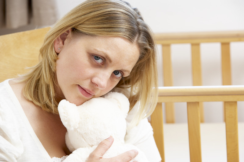 Sad mom with teddy.jpg