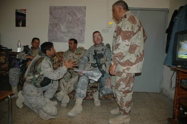 Using an interpreter to plan a joint mission with our Iraqi Army counterparts.