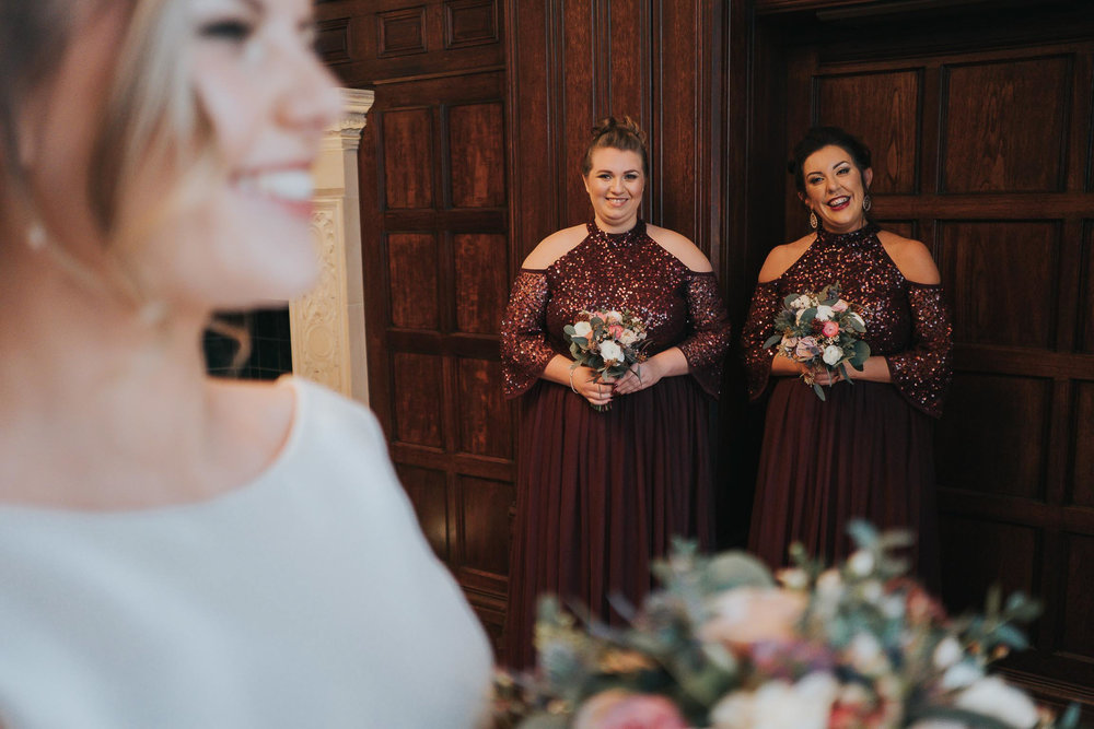 bridesmaids looking at their bride on her wedding day