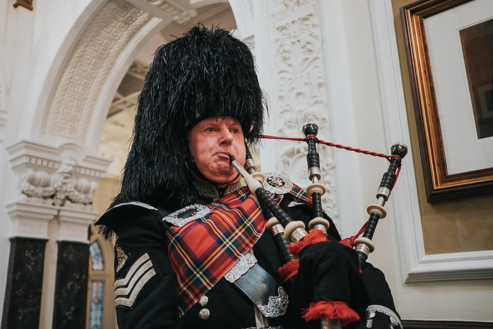 bagpipe player at a wedding in Liverpool