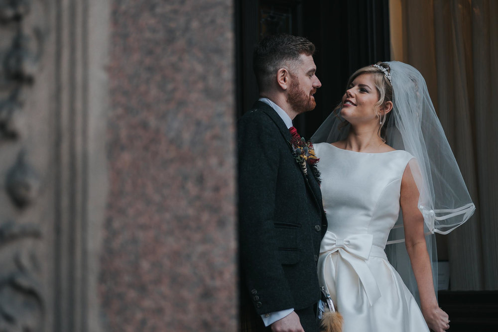 a very happy bride and groom after their wedding ceremony