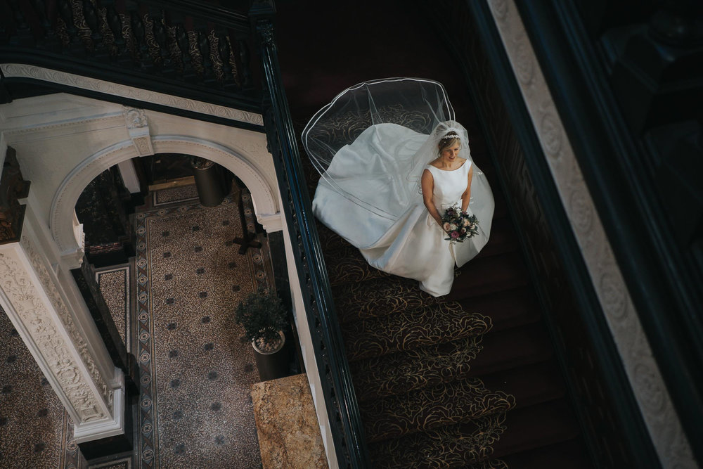 stunning bride in her wedding dress on the stairs in Liverpool