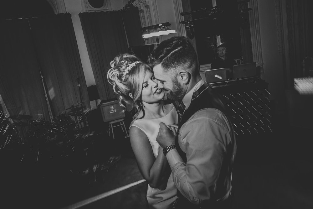 black and white image of bride and groom during their first dance at the double tree by Hilton in Liverpool city centre
