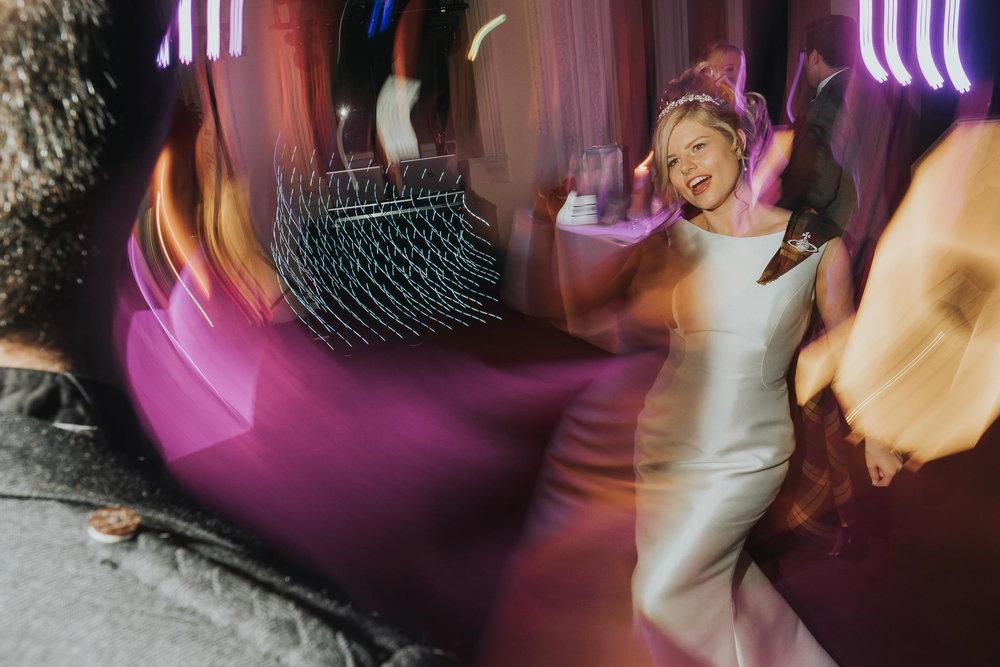 happy bride enjoying a dance on her wedding day