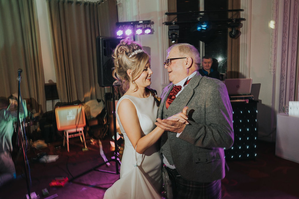 bride and father dance in the Double Tree by Hilton in Liverpool