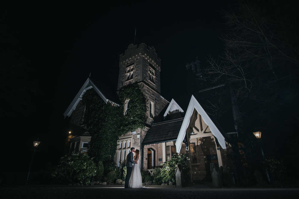 bride and groom at west tower exclusive wedding venue in ormskirk in the evening