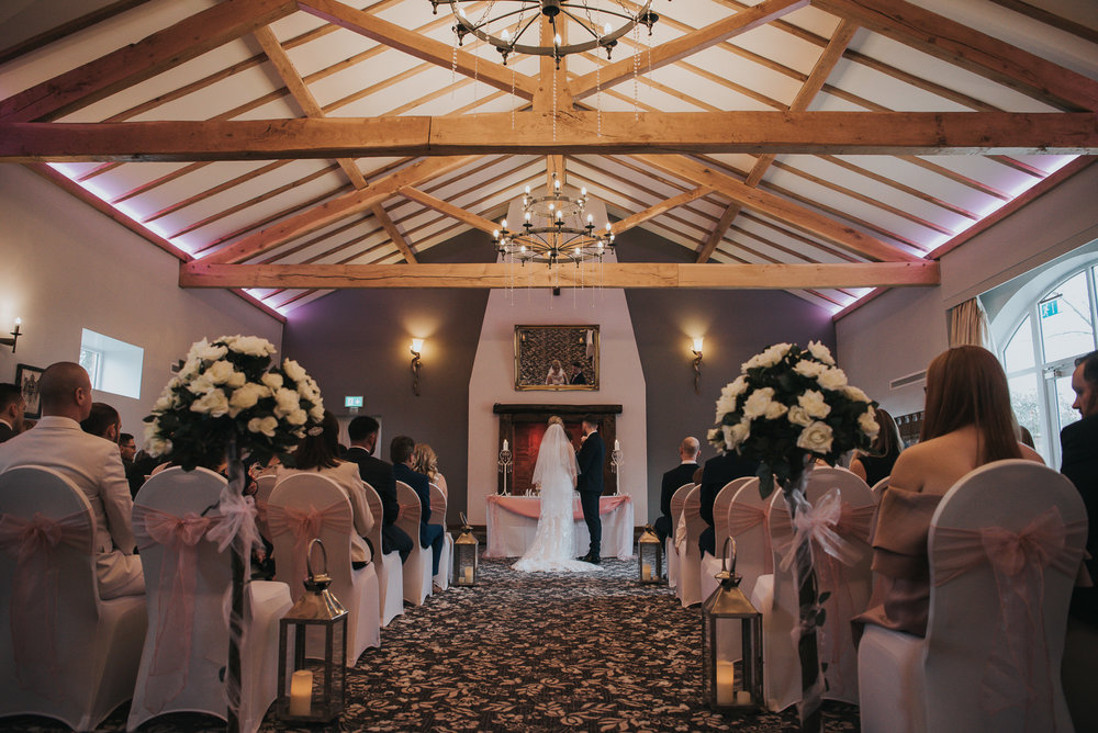images of the bride and groom during their wedding day ceremony  at The Villa in Wrea Green