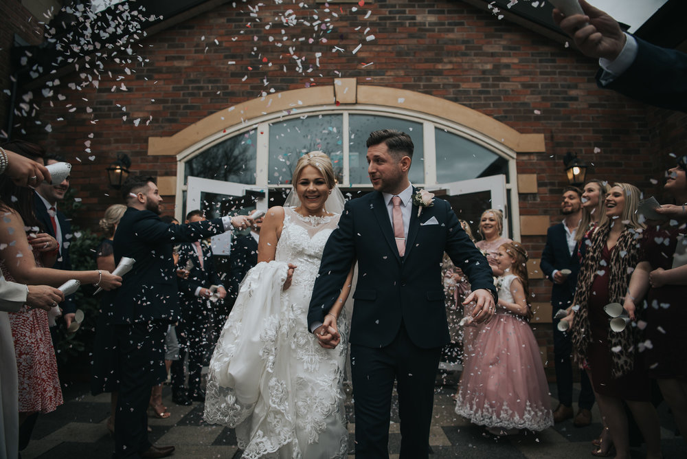 amazing confetti shot during the newly wed couple  at The Villa in Wrea Green