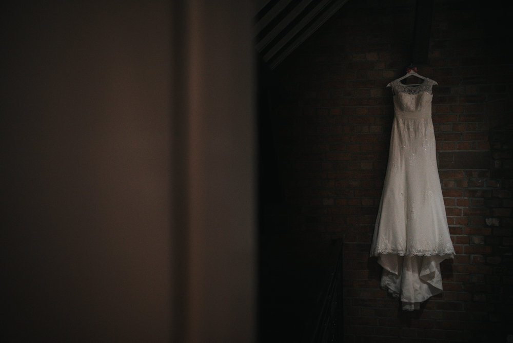 The wedding dress hanging in the Grosvenor Pulford on the wedding day