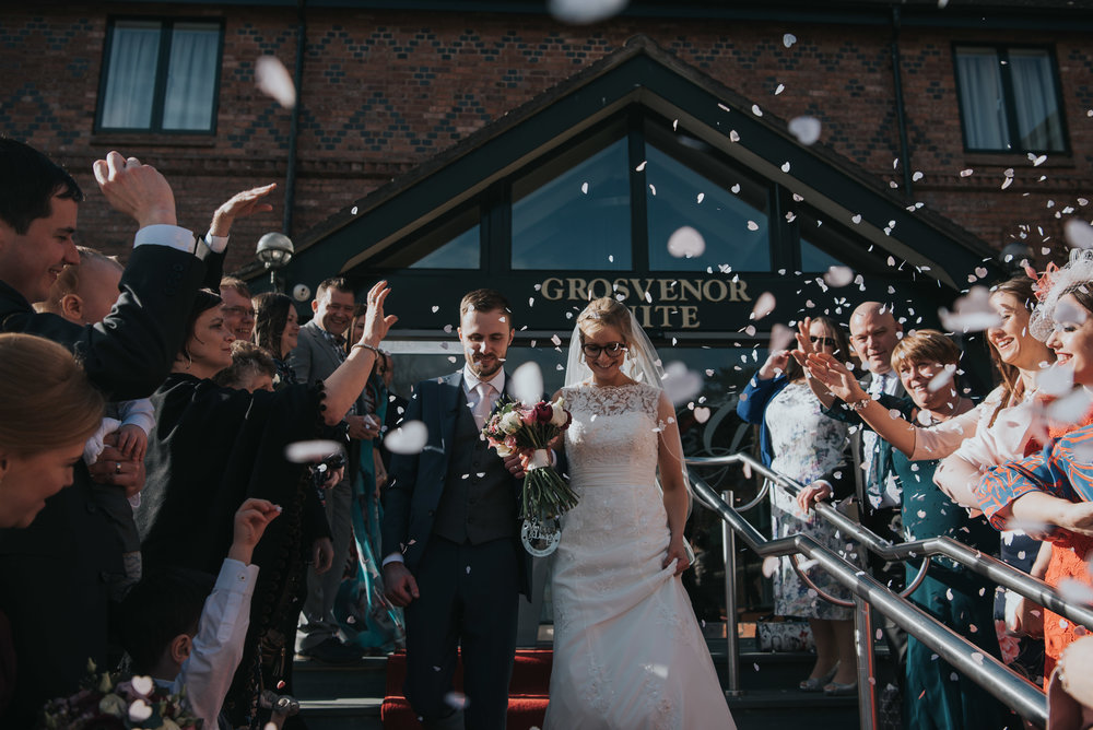 Lovely confetti shot outside the Grosvenor Pulford on their wedding day