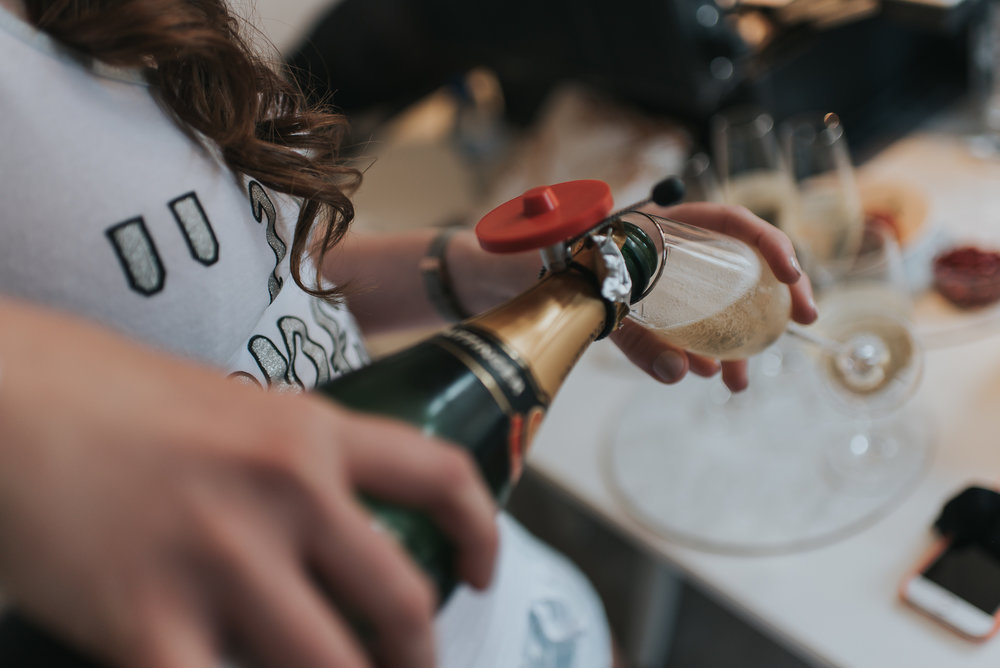 pouring drinks on wedding day before tying the knot