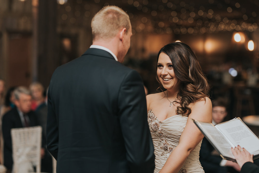 bride saying her vows to her groom on their wedding day at Alcumlow Hall Farm
