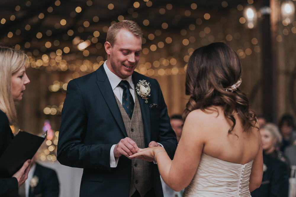 the groom saying his vows to his bride on their wedding day at Alcumlow Hall Farm