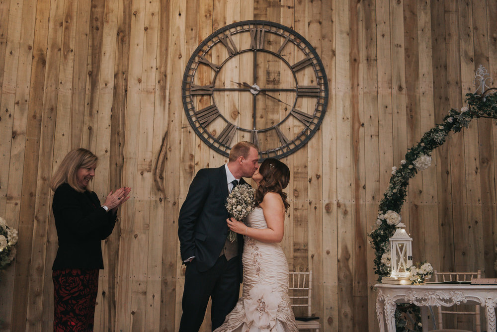 the first kiss on the wedding day at Alcumlow Hall Farm