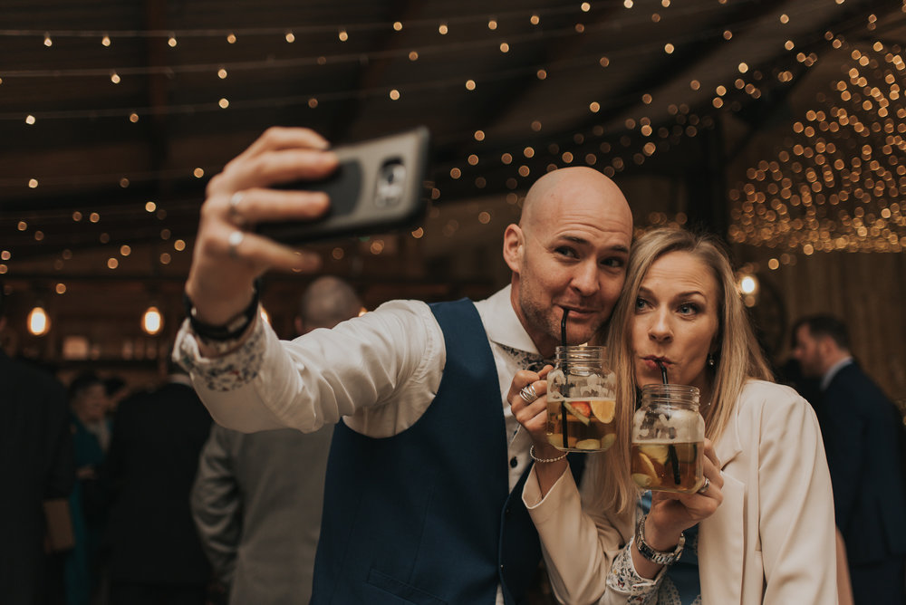 wedding selfie by two of the guests