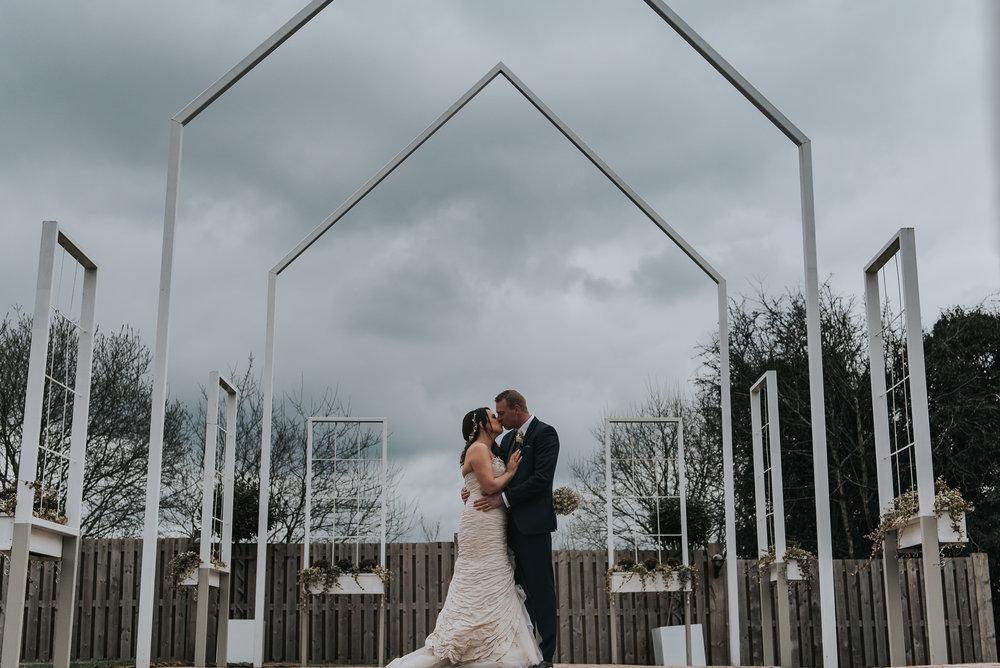 bride and groom enjoying their wedding at Alcumlow Hall Farm