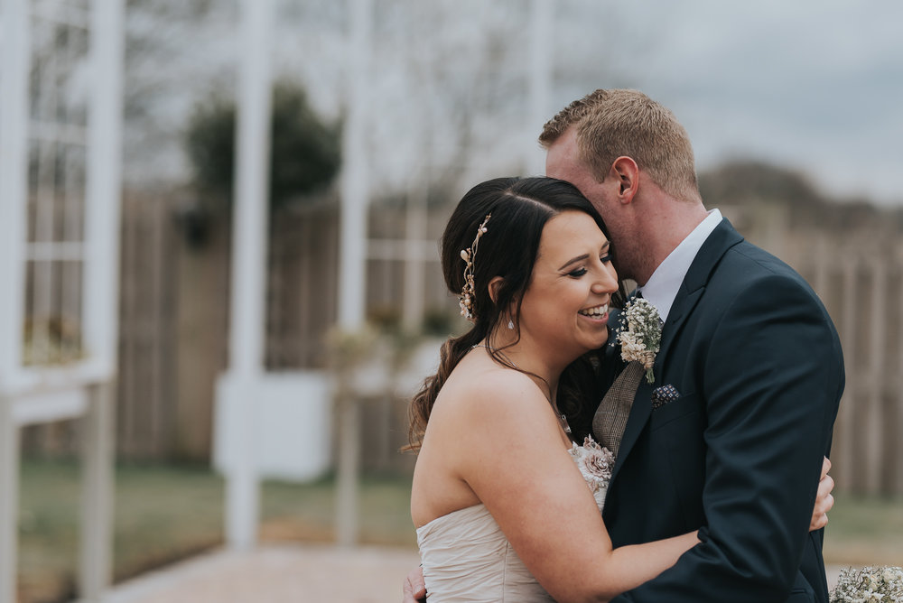 bride and grooms relaxed portraits at Alcumlow Hall Farm