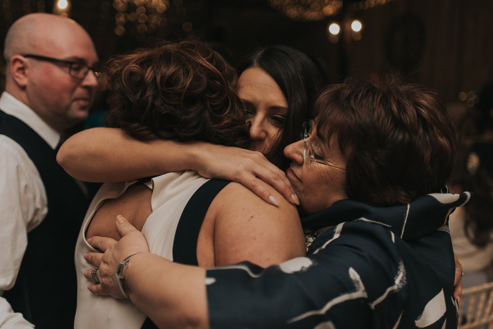 emotional moment at a stunning rustic wedding