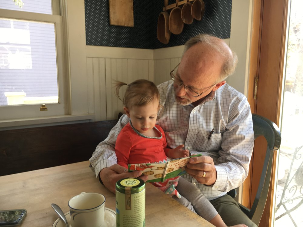 "My niece in the Bostroms' sunny Colorado kitchen, enjoying story time with Mr. Gary Bostrom (March 2017).  A big ""Thank you"" to my sister for sharing this beautiful photo."
