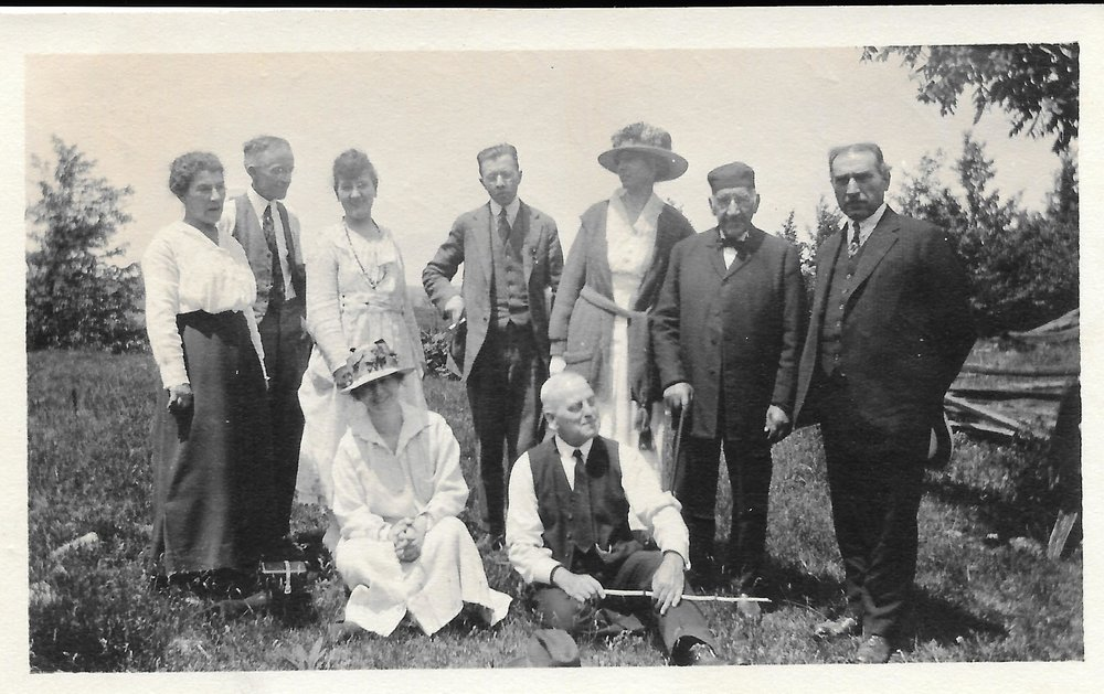 A snapshot Great-Grandpa George took when they arrived at the picnic site, gentlemen in full three-piece suits and ladies showing off their magnificent summer hats...love those hats, ladies!