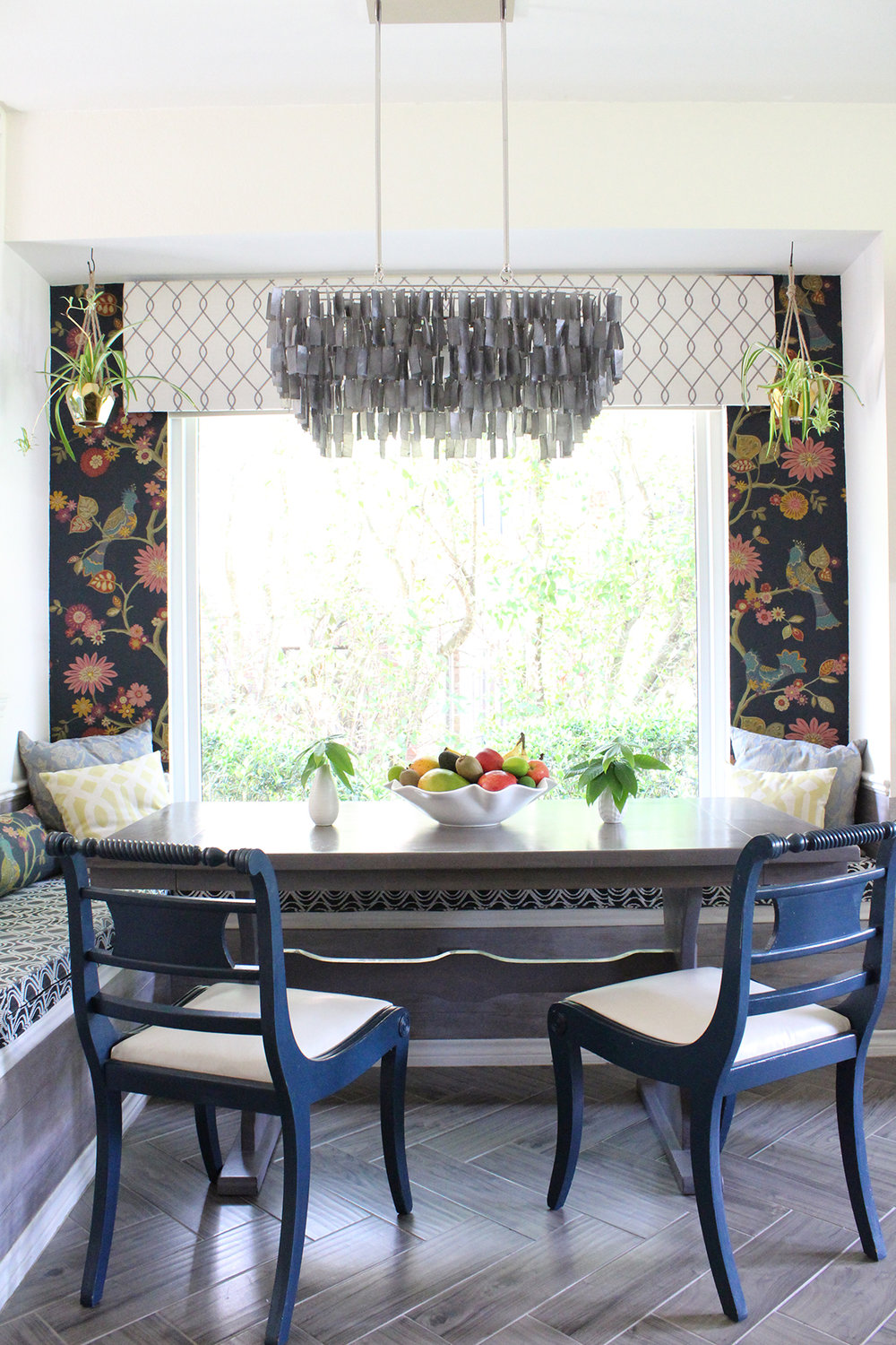 Breakfast nook featuring fabric wallpaper, capiz chandelier and herringbone tile floors by Kristin Laing Designs