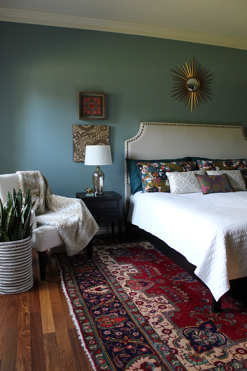 Bedroom with vintage persian rug and Farrow and Ball Oval Room Blue on the wall by Kristin Laing Design